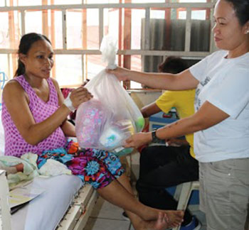 Gift Giving In San Marcelino Hospital 2015.